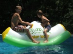 Inflatable water teetor totter for kids pool games