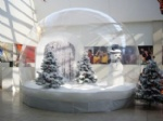 Clear inflatable Christmas human size snow globe with snowman for sale